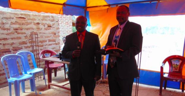 Two men standing preaching God's Word