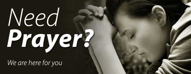 "An image a person with their hands folded in prayer. Text appears staying, ""Need prayer? We are here for you!"""