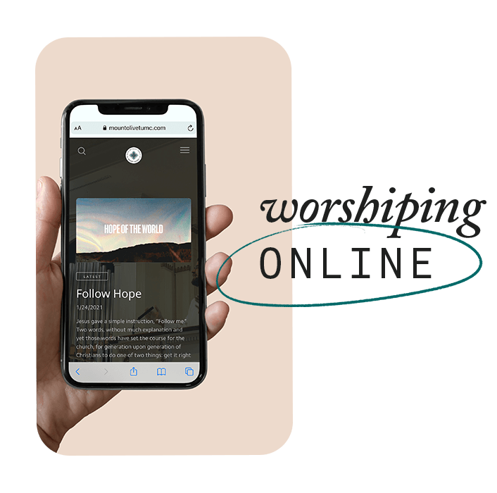 Image of a hand holding a phone with the online worship service on screen
